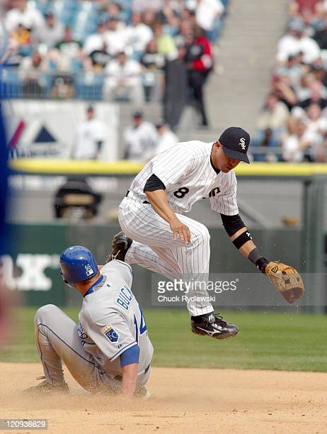 Chicago White Sox' 2nd Baseman Alex Cintron turns a double play during their game against the Kansas City Royals April 19 2006 at US Cellular Field...