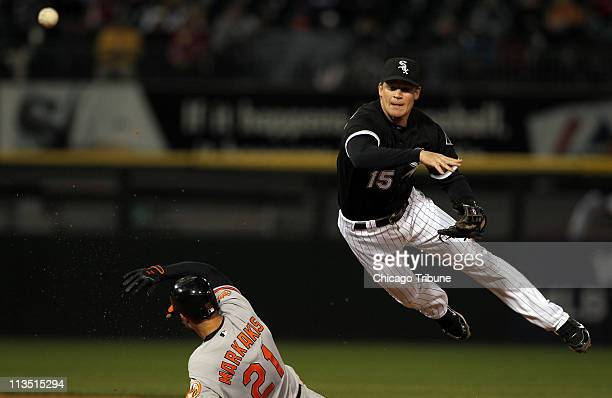 Chicago White Sox 2nd baseman Gordon Beckham forces out Baltimore Orioles' Nick Markakis at 2nd and fires to first to doubleup Derrek Lee in the 5th...