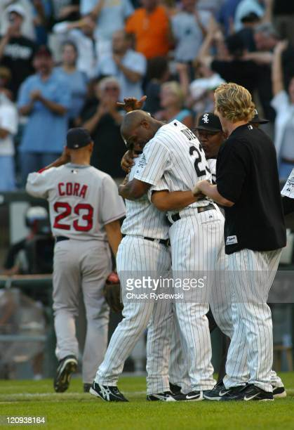 Chicago White Sox' 2nd Baseman Tadahito Iguchi gets a big hug from teammate Jermaine Dye after driving in the winning run against the Boston Red Sox...