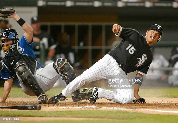 Chicago White Sox' 2nd Baseman Tadahito Iguchi is out at home plate after trying to score from 1st base on Jim Thome's double during their game...
