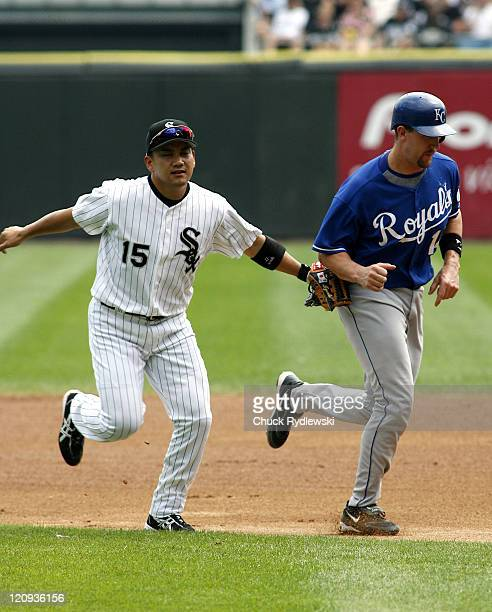 Chicago White Sox' 2nd Baseman, Tadahito Iguchi, tags out John Buck after a run-down during their game against the Kansas City Royals August 17, 2006...