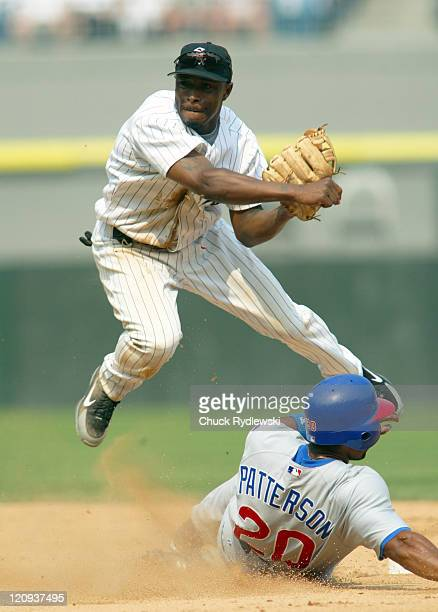 Chicago White Sox 2nd Baseman Willie Harris turns a double play during the Interleague game against the Chicago Cubs June 26 2005 at US Cellular...