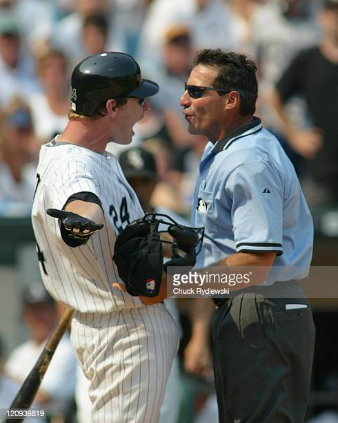 Chicago White Sox 3rd Baseman Joe Crede and Home Plate Umpire Angel Hernandez have a heated exchange during the Interleague game against the Chicago...