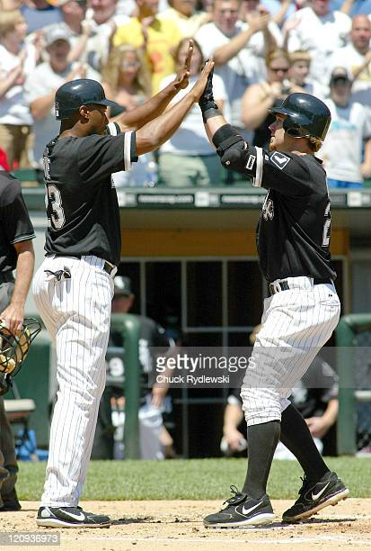 Chicago White Sox' 3rd Baseman Joe Crede gets congratulated at home plate by teammate Jermaine Dye after hitting a 2run home run during their game...