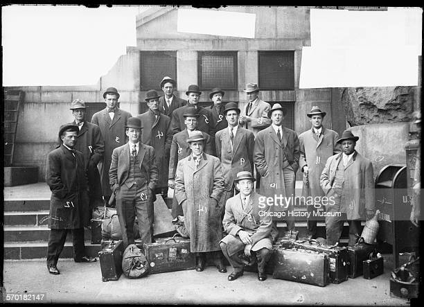 Chicago White Sox baseball players and men associated with the team wearing suits standing on a sidewalk and steps in front of a building Chicago...