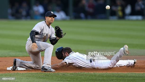 Chicago White Sox baserunner Adam Eaton steals second base as New York Yankees second baseman Brian Roberts takes a late throw in the first inning at...