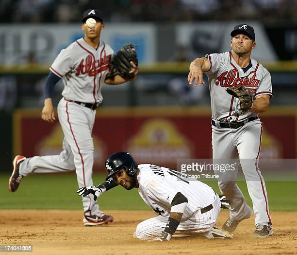 Chicago White Sox baserunner Alexei Ramirez is forced at second base as Atlanta Braves second baseman Dan Uggla completes a double play in the fifth...