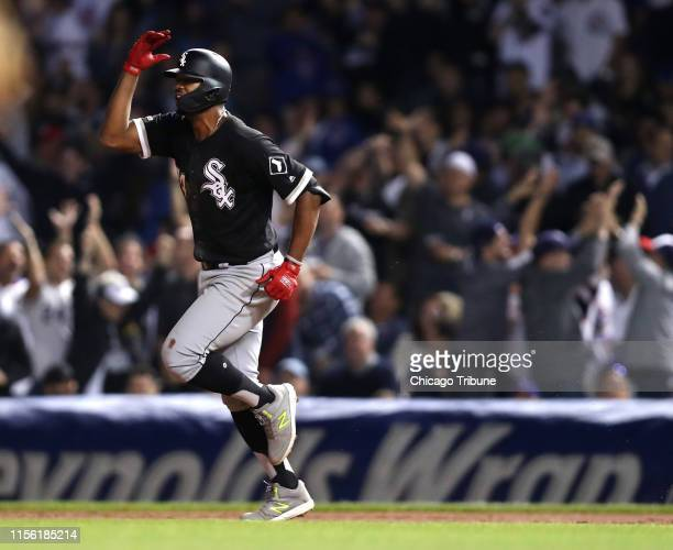 Chicago White Sox batter Eloy Jimenez celebrates as he rounds the bases after his tworun home run in the ninth inning of a 31 win against the Chicago...