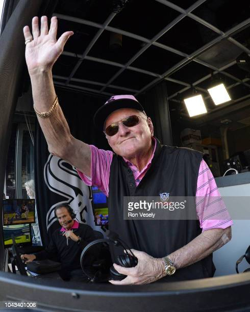 Chicago White Sox broadcaster Ken 'Hawk' Harrelson acknowledges the Chicago White Sox players and staff on the field as he wrapped up his final game...