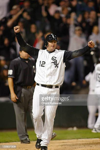 Chicago White Sox' Catcher AJ Pierzynski celebrates scoring the winning run during their game the against Oakland Athletics May 22 2006 at US...