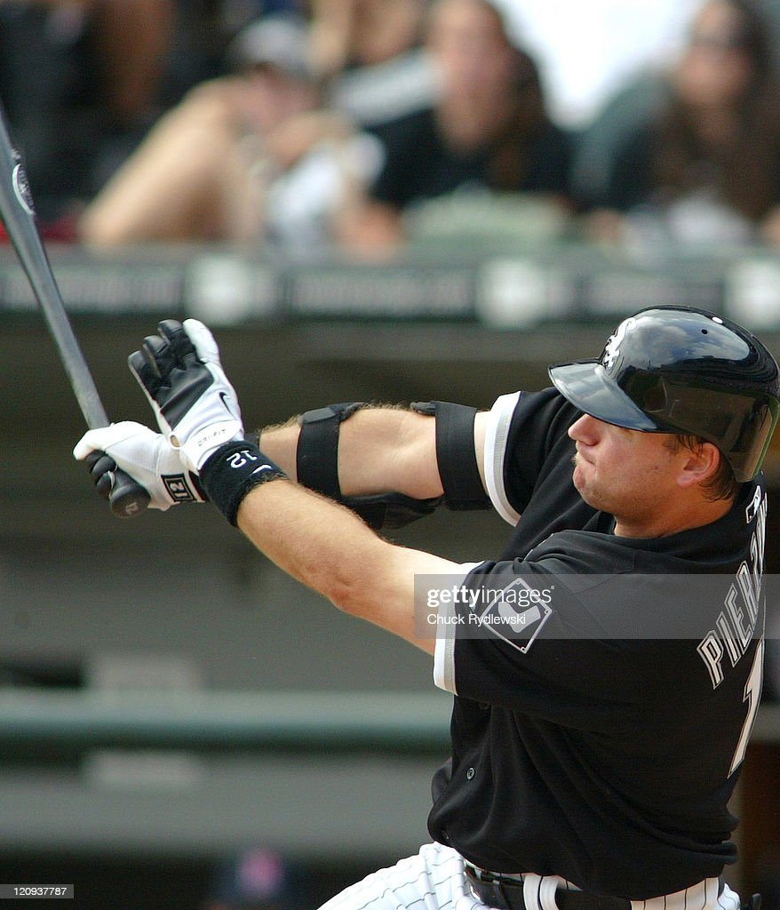 Chicago White Sox' catcher, A.J. Pierzynski, follows through on his two-run homer in the 5th inning during their game against the Minnesota Twins August 27, 2006 at U.S. Cellular Field in Chicago, Illinois. The White Sox defeated the Twins 6-1.