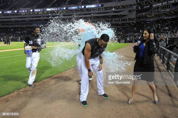 Chicago White Sox catcher Omar Narvaez dunks first baseman Jose Abreu after Abreu's game winning two run RBI single next to second baseman Alen...