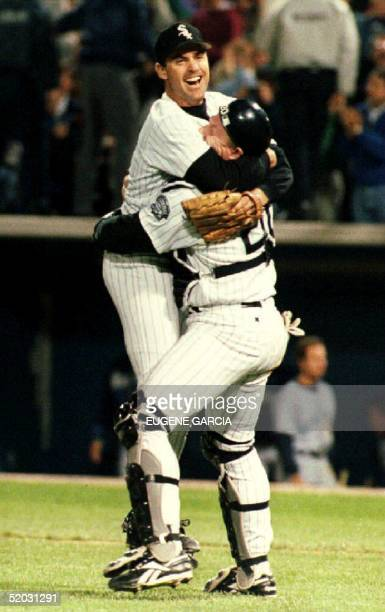 Chicago White Sox catcher Ron Karkovice hugs pitcher Kirk McCaskill after the final out against the Seattle Mariners to win the American League West...