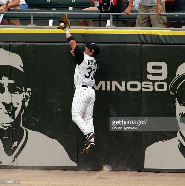 Chicago White Sox Center Fielder Aaron Rowand robs Vladimir Guerrero of a home run during the game against the Los Angeles Angels September 11 2005...