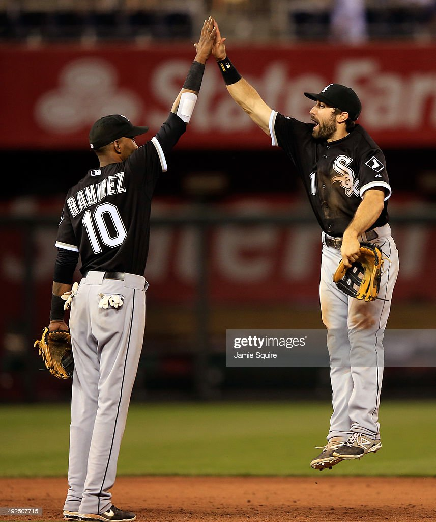 Chicago White Sox center fielder Adam Eaton #1 leaps to high-five shortstop Alexei Ramirez #10 after the White Sox defeated the Kansas City Royals 7-6 to win the game at Kauffman Stadium on May 20, 2014 in Kansas City, Missouri.