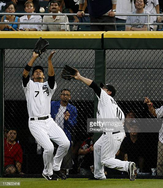 Chicago White Sox centerfielder Jerry Owens left and right fielder Rob Mackowiak go for a fly out from Detroit Tigers' Sean Casey in the third inning...