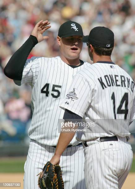 Chicago White Sox' Closer Bobby Jenks celebrates with teammate Paul Konerko after closing out the Toronto Blue Jays April 15 2006 at US Cellular...