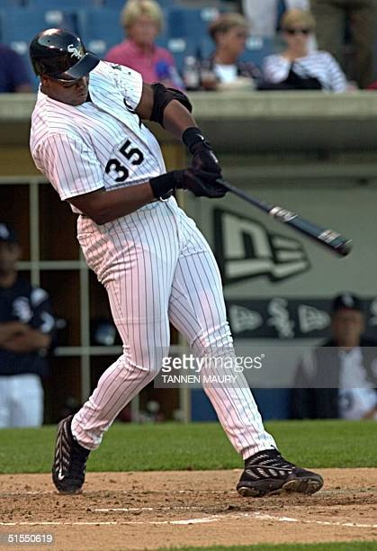 Chicago White Sox designated hitter Frank Thomas belts a 3RBI home run off St Louis Cardinal pitcher Darryl Kile in the first inning 15 July 2000 in...