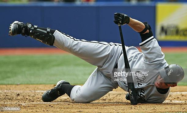 Chicago White Sox DH Jim Thome ends up in an awkward position on the ground after backing away from an inside pitch vs the Toronto Blue Jays at...