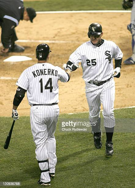 Chicago White Sox' DH Jim Thome is greeted by teammate Paul Konerko after his 3rd inning home run during their game versus the Texas Rangers April 17...