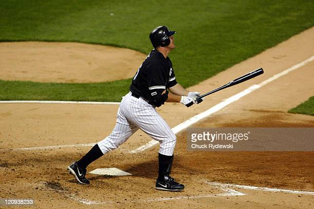 Chicago White Sox' DH/1B Jim Thome watches his 3rd inning 3run home run sail into the right field bleachers during their game against the Los Angeles...