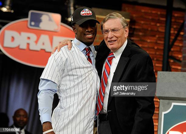 Chicago White Sox draftee Tim Anderson poses for a photo with Major League Baseball Commissioner Bud Selig at the 2013 MLB FirstYear Player Draft at...