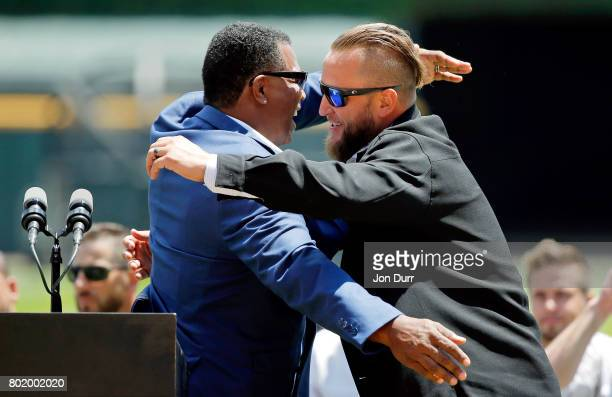 Chicago White Sox Executive Vice President Ken Williams hugs former Chicago White Sox pitcher Mark Buehrle during a ceremony to retire his number #56...