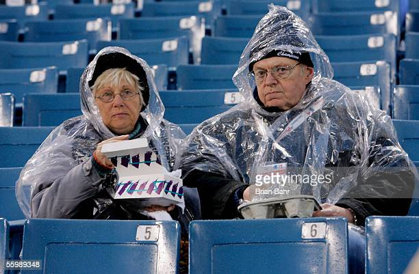 Chicago White Sox fans bundle up in rain gear before the start of Game Two of the 2005 Major League Baseball World Series between the Chicago White...
