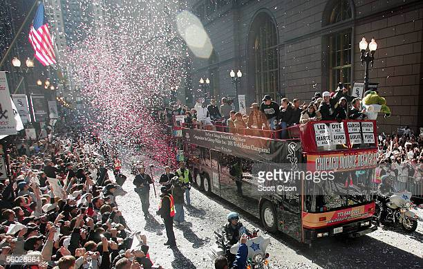 Chicago White Sox fans cheer as members of the team pass by on buses during a parade through the city's downtown October 28 2005 in Chicago Illinois...