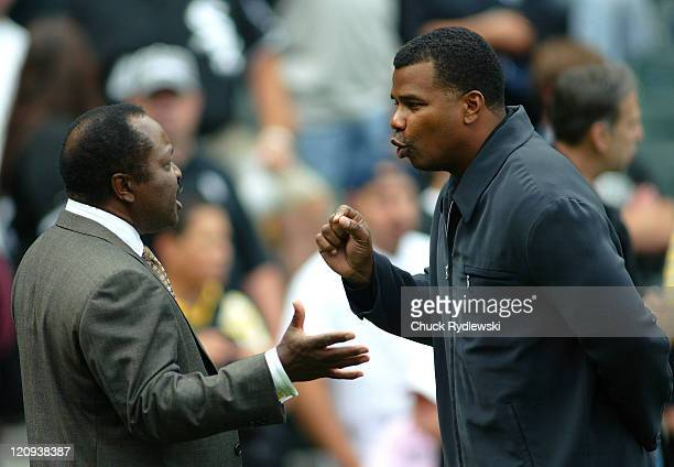 Chicago White Sox' General Manager Kenny Williams has an animated discussion with ESPN announcer Joe Morgan prior to their game against the Houston...