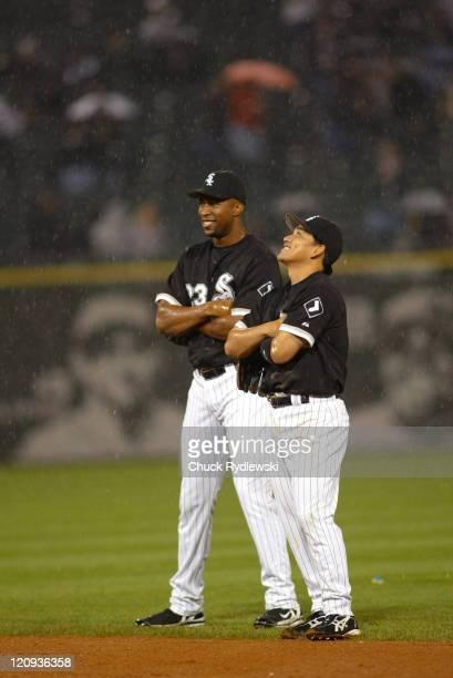 Chicago White Sox' Jermaine Dye and Tadahito Iguchi enjoy a laugh while waiting for a pitching change during their 125 loss to the the Los Angeles...
