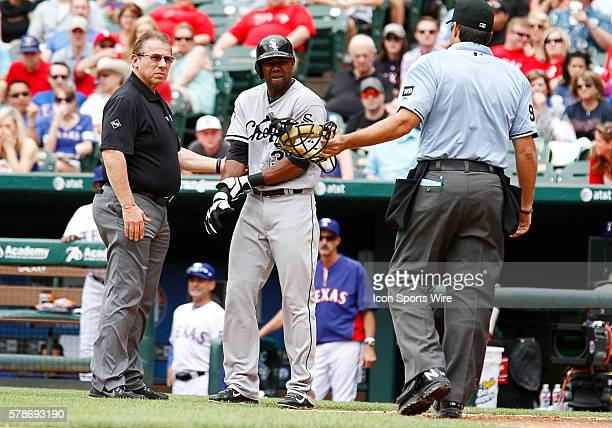 Chicago White Sox Left field Alejandro De Aza [6186] winces as he claims the ball hit him or was fouled off it was ruled a swing and miss after...