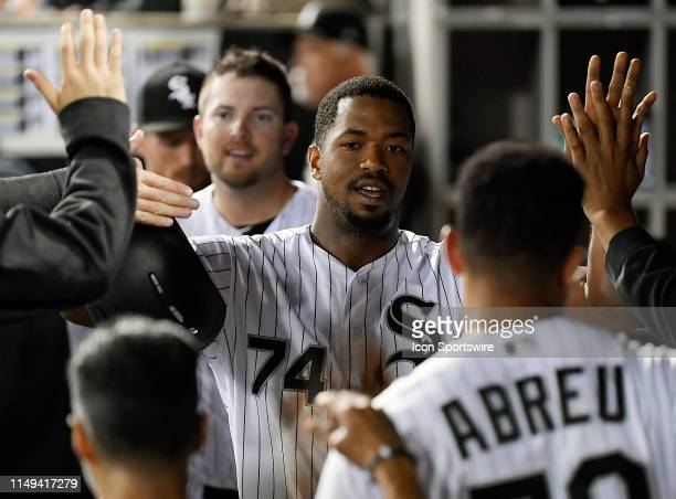 Chicago White Sox left fielder Eloy Jimenez celebrates in the dugout with teammates after scoring in the sixth inning against the Washington...