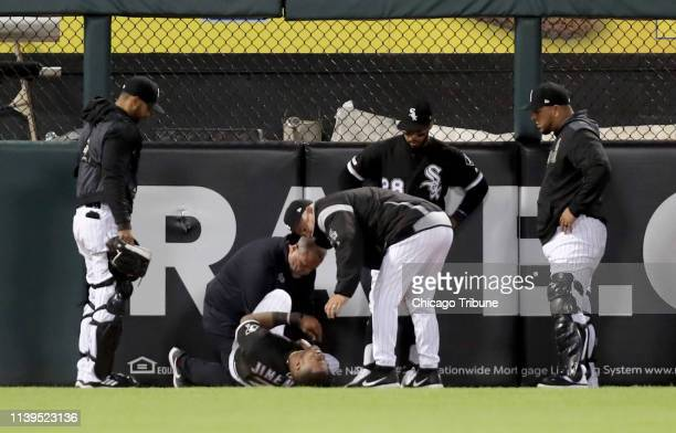 Chicago White Sox left fielder Eloy Jimenez lays on the ground after suffering an injury in the third inning against the Detroit Tigers at Guaranteed...