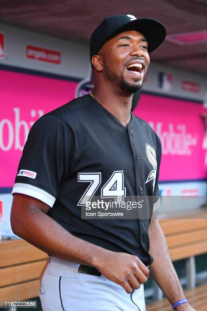 Chicago White Sox left fielder Eloy Jimenez looks on in the dugout before a MLB game between the Chicago White Sox and the Los Angeles Angels of...