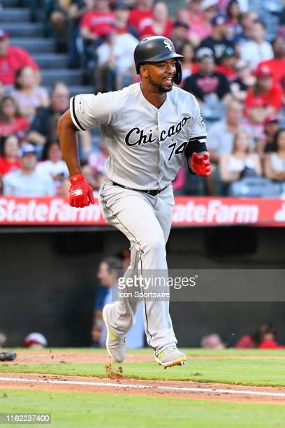 Chicago White Sox left fielder Eloy Jimenez runs to first base after a hit during a MLB game between the Chicago White Sox and the Los Angeles Angels...