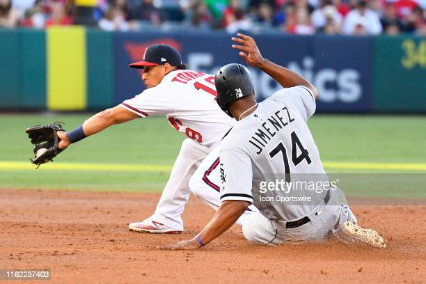 Chicago White Sox left fielder Eloy Jimenez slides safely into second before the tag of Los Angeles Angels shortstop Wilfredo Tovar during a MLB game...