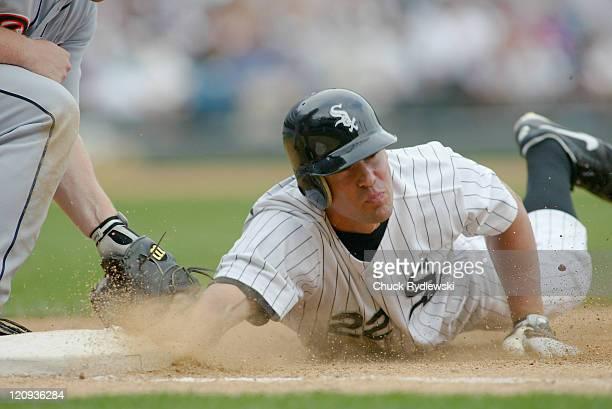 Chicago White Sox Left Fielder Scott Podsednik dives safely into 1st base during the game against the Detroit Tigers September4 2005 at US Cellular...