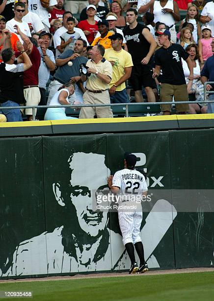 Chicago White Sox Left Fielder, Scott Podsednik, has a front row seat to watch Detroit Tigers 3rd Baseman, Brandon Inge's 1st pitch of the game home...