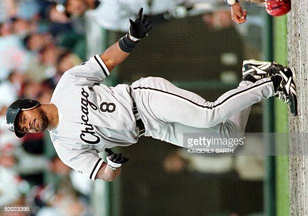 Chicago White Sox leftfielder Albert Belle watches the flight of the ball as he hits a threerun home run over the wall off pitcher Chad Ogea of the...