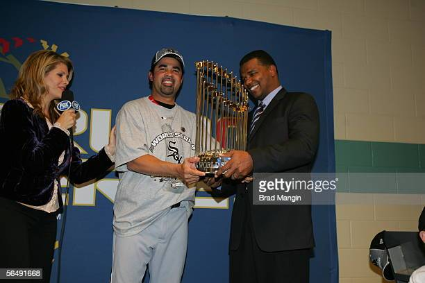 Chicago White Sox Manager Ozzie Guillen holds the World Series trophy after his team defeated the Houston Astros at Minute Maid Park on October 26...