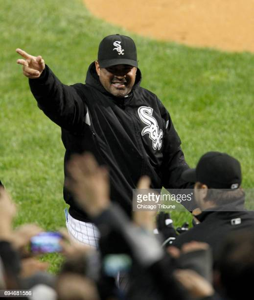 Chicago White Sox manager Ozzie Guillen waves to the fans at the end of a 43 win against the Toronto Blue Jays at US Cellular Field in Chicago on...