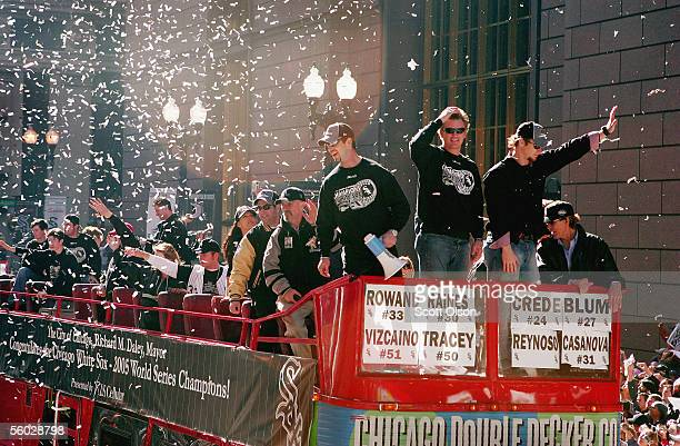 Chicago White Sox members Aaron Rowand Geoff Blum and Joe Crede respond to fans during a parade downtown October 28 2005 in Chicago Illinois Chicago...