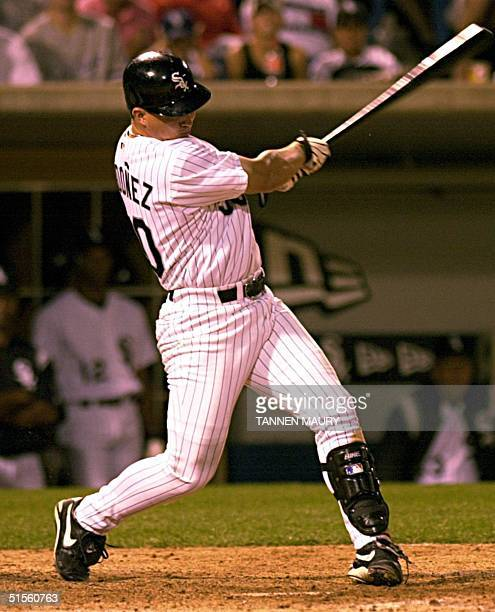 Chicago White Sox outfielder Magglio Ordonez launches a home run off Kansas City Royals pitcher Mac Suzuki in the seventh inning 24 July 2000 in...