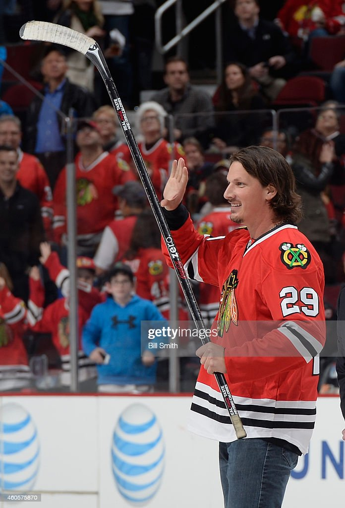 Chicago White Sox pitcher Jeff Samardzija #29 waves to the crowd after shooting the puck in between periods of the NHL game between the Minnesota Wild and the Chicago Blackhawks at the United Center on December 16, 2014 in Chicago, Illinois.
