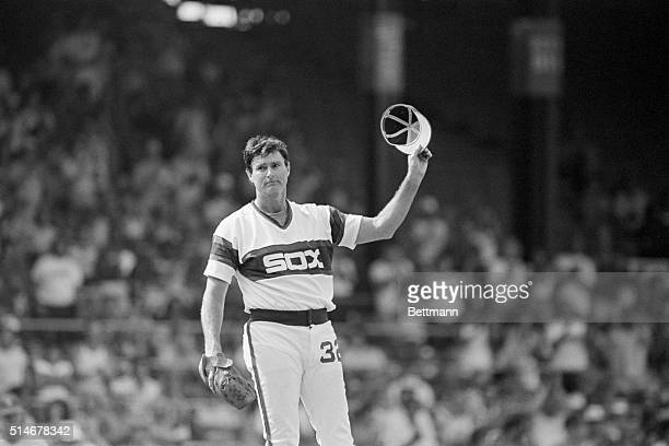 Chicago White Sox pitcher Steve Carlton tips his cap to the fans after he became the 10th pitcher in major league history to pitch 5000 career...