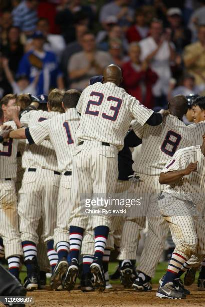 Chicago White Sox players mob catcher AJ Pierzynski after he hit a game winning home run to end the Interleague game against the Los Angeles Dodgers...