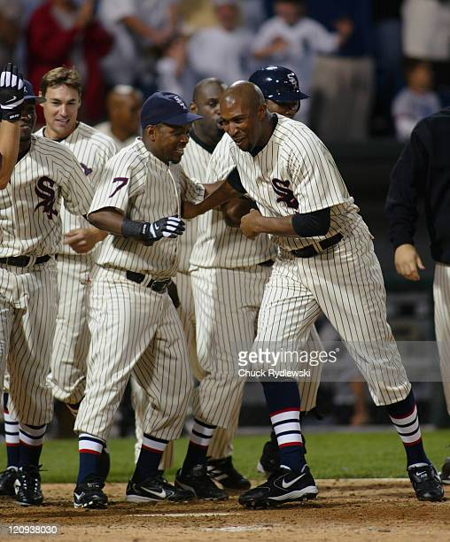 Chicago White Sox players wait for AJ Pierzynski after he hit a game winning home run to end the Interleague game against the Los Angeles Dodgers...