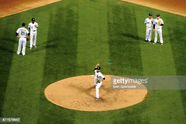 Chicago White Sox relief pitcher Zach Putnam warms up while Chicago White Sox third baseman Todd Frazier Chicago White Sox shortstop Tim Anderson...