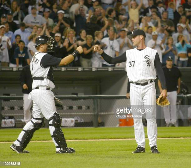 Chicago White Sox' reliever Matt Thornton gets congratulated by AJ Pierzynski after closing out the Baltimore Orioles July 6 2006 at US Cellular...